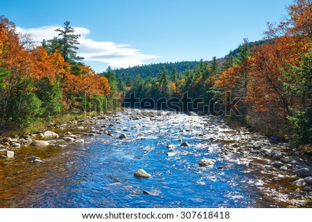 Swift River at autumn in White Mountain National Forest, New Hampshire, USA. - stock photo