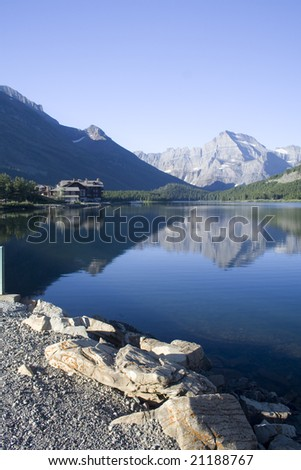 Swiftcurrent lake and reflection in Glacier National Park - stock photo