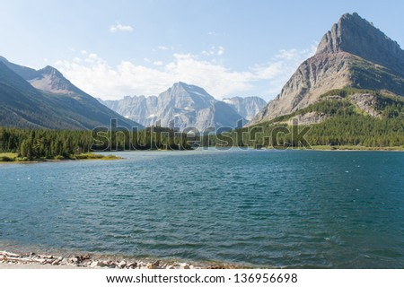 Swiftcurrent Lake in Glaciers National Park - stock photo