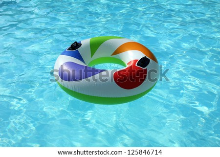 swim ring floating on a blue swimming pool - stock photo