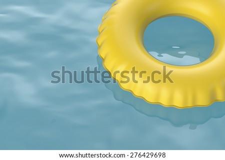Swim ring floating on water - stock photo