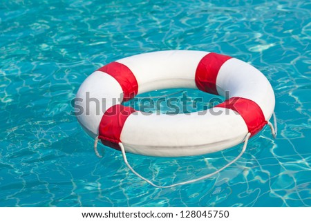 Swim ring in a swimming pool - stock photo