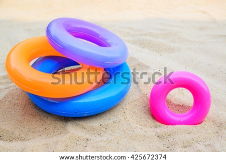 Swim ring , pool ring isolated on beach background - stock photo