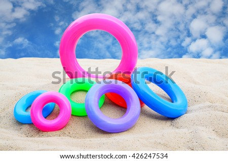 Swim ring , pool ring on beach and blue sky background - stock photo