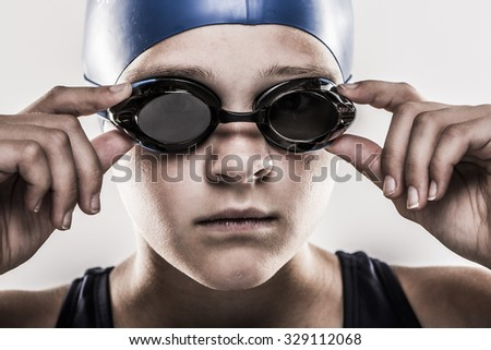 Swimmer girl with goggles - stock photo