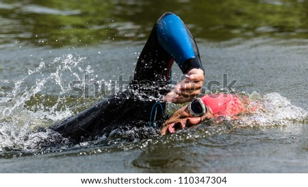 swimmer in a triathlon competition - stock photo