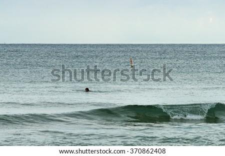 Swimmer in the ocean - stock photo
