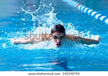 Swimmer in waterpool swim one of swimming style - stock photo