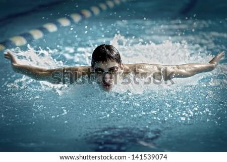 Swimmer in waterpool swim one of swimming style - stock photo