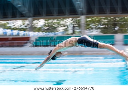Swimmer Jumping and bluring movement to pool for train - stock photo