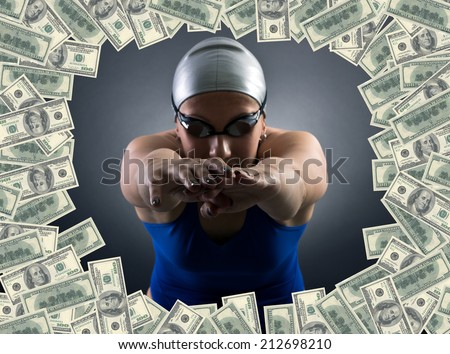 Swimmer jumping into the sea of money. - stock photo