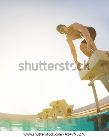 swimmer swimming competition pool.starting block in a swimming pool - stock photo