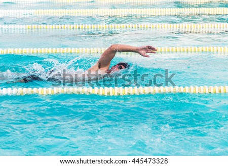 swimmer swimming the front crawl in the pool