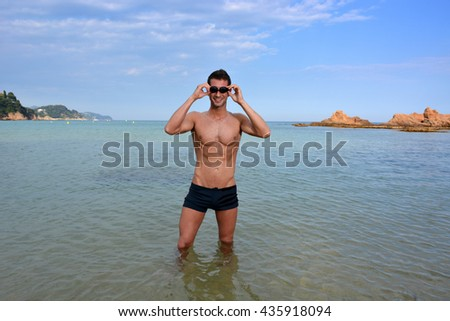 swimmer training on the beach in the evening