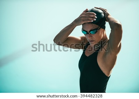 Swimmer warming up for race - stock photo