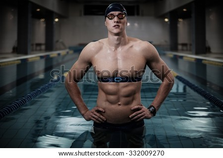 Swimmer with heart rate monitor in swimming pool - stock photo