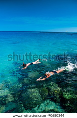 Swimmers snorkeling - stock photo