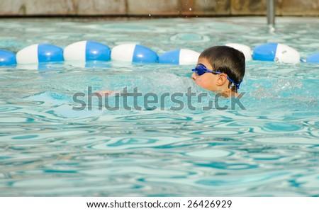Swimming boy - stock photo