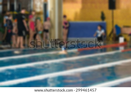 Swimming competition at fitness centre theme creative abstract blur background with bokeh effect