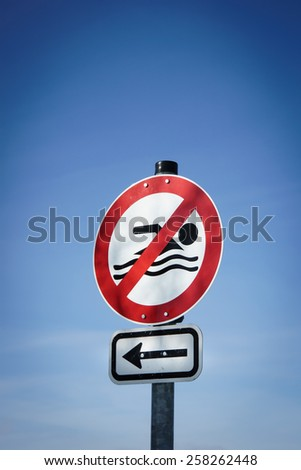 swimming forbidden - no swimming sign - stock photo