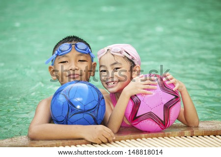 swimming kid and family - stock photo