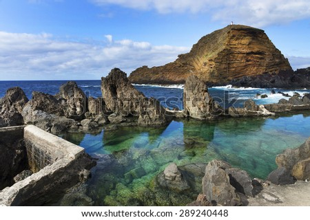 Swimming natural pools of volcanic lava in Porto Moniz, Madeira island, Portugal, Europe - stock photo
