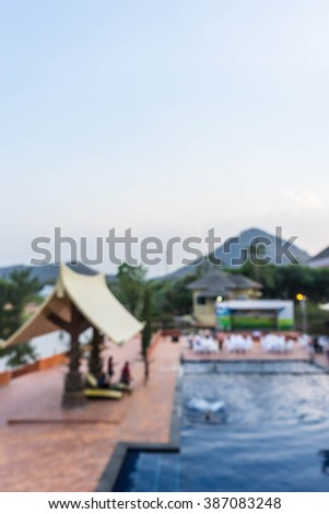 swimming pool among hill , blur for background