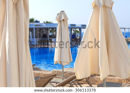 Swimming pool and beach of the luxury hotel - stock photo