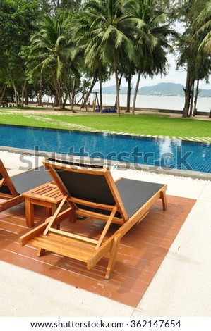 swimming pool and deck chair with sea view