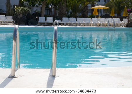 Swimming Pool and palm tree - stock photo