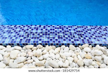 swimming pool and rock border - stock photo