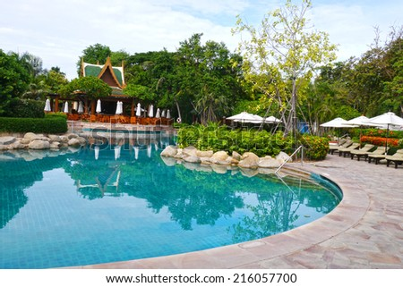Swimming pool at luxury resort for recreation - stock photo