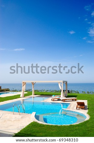 Swimming pool at luxury villa, Crete, Greece - stock photo