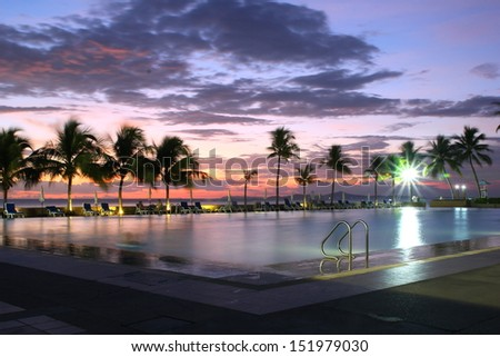 Swimming Pool at sunset.  - stock photo