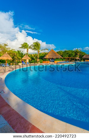 Swimming pool at the luxury mexican resort at early morning hours. Vertical.