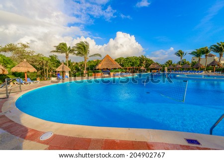 Swimming pool at the luxury mexican resort,  early morning hours.