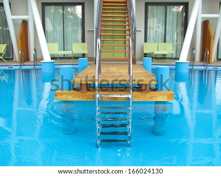 Swimming pool at the spa hotel - stock photo