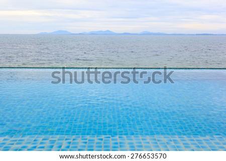 Swimming pool beside the sea - stock photo