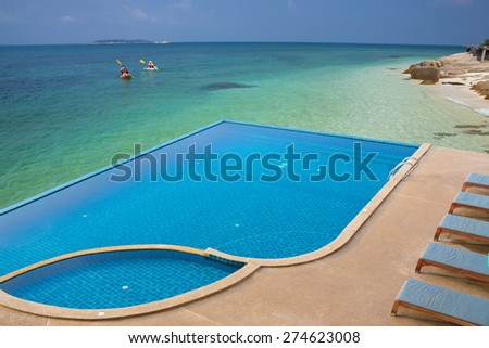 Swimming pool by the beach  - stock photo