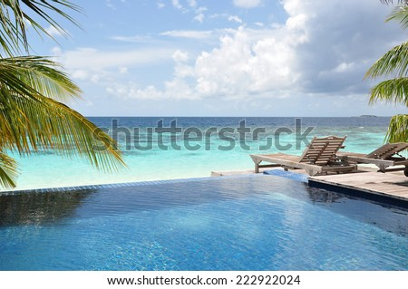 Swimming pool by the beach in Maldives. - stock photo