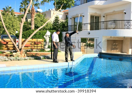 Swimming pool cleaner and property owner. - stock photo