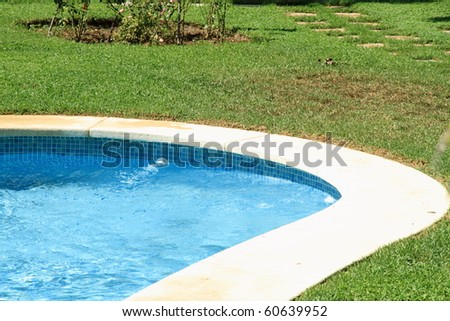Swimming pool detail and garden Godella Valencia Spain - stock photo