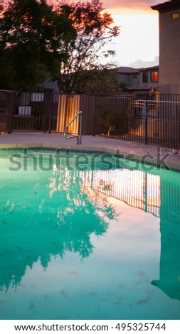 Swimming pool in Arizona backyard at late evening during monsoon season in Phoenix, Arizona