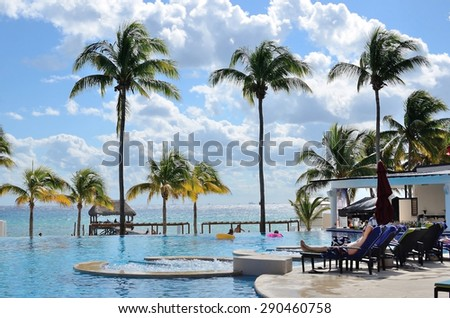 Swimming pool in Azul Fives hotel in Playa del Carmen on the Riviera Maya, Mexico on 14 of December 2014. - stock photo