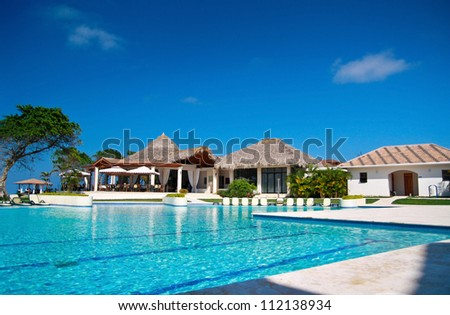 Swimming pool in caribbean resort, Dominican Republic - stock photo