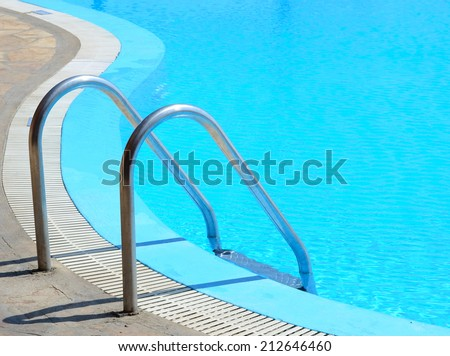 Swimming pool in curved shhape with stairs - stock photo