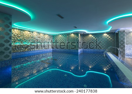 Swimming pool in luxury hotel spa center  - stock photo