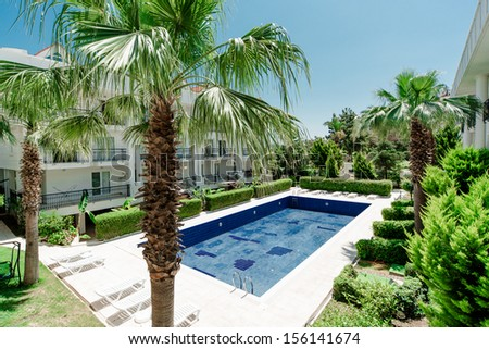 Swimming pool in the residence - stock photo