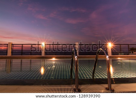 Swimming pool in twilight sky - stock photo