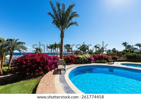 Swimming pool in typical Egyptian hotel - stock photo